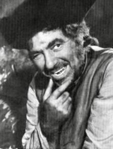 Robert Newton as Long John Silver.